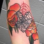 heart spiderweb tattoo